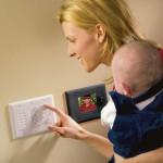 woman and baby at intercom