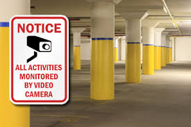 Garage with Security Cameras Sign