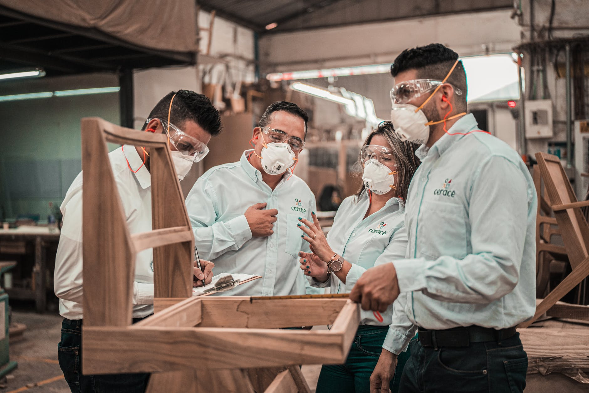 new york warehouse employees wearing face masks during covid-19